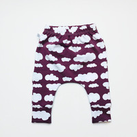 Plum baby infant harem pants with white clouds. Slim fit harem pants with cuffs. Purple jersey knit fabric. Stylish Infant pants