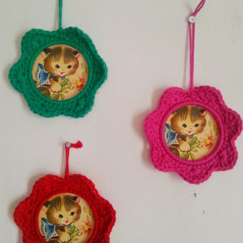 Colorful crochet photo frame with vintage cat picture