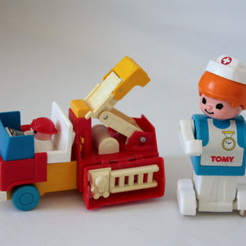 Set of two vintage Fisher Price toys / truck crane / Nurse / Child game