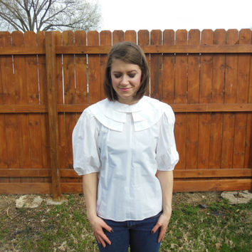 Vintage 1980's Victorian style blouse, with round tiered collar and elbow length, puffy sleeves.