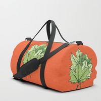 Green Maple Leaves On Vibrant Orange Duffle Bag by borianagiormova