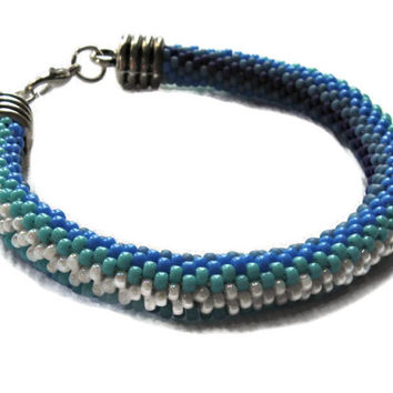 Bead crochet spiral bracelet in different blue shades. Seed bead jewelry