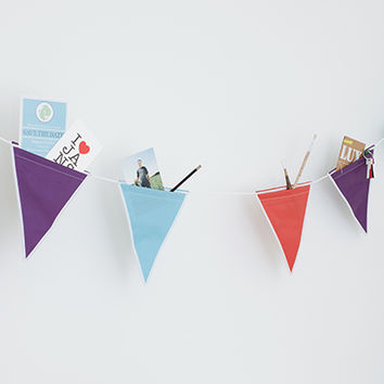 Kikkerland Design Inc » Products » Festive Storage Bunting Flag Banners