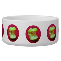 Green apple on red background dog food bowl