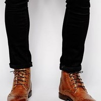 ASOS   ASOS Brogue Boots in Leather With Shearling Look Lining at ASOS