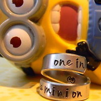 one in a minion , googles inside aluminum twist ring