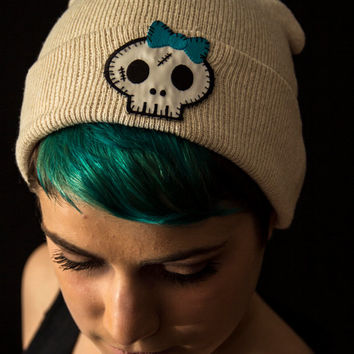 Cream colored Winter Beanie with Skeleton Stitches Patch Handsewn with Blue Bow - Custom Winter Hat -