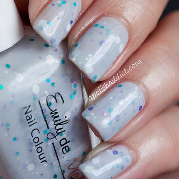 "Nail polish - ""Harmony"" white, turquoise, and purple glitter in a light grey base"