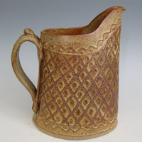 Pitcher with impressed pine design