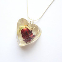 Beautiful Real Romantic Red Rose Bud encased in a Crystal Clear Glass like Resin Heart, attached to a Sterling Silver 18 inch Snake Chain