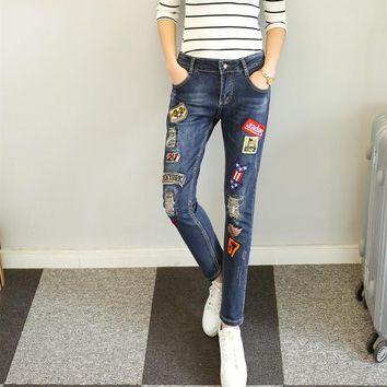 Fashion Personality Badge Pattern Patch Ripped Worn Beggar Long Jeans