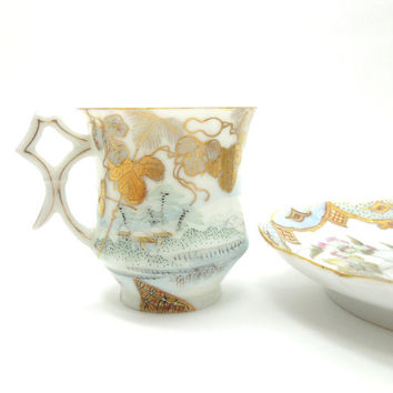 Antique eggshell porcelain demitasse cup tea cup and saucer - Gold trim leaves village scene scalloped edge saucer