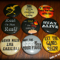 Nine Ultimate Hunger Games inspired 1 Pin Back by MudInMyBlood