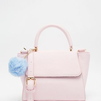 Skinnydip Small Cross Body in Pink With Pom Pom at asos.com