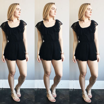 An Off the Shoulder Romper in Black