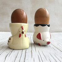 Vintage egg cups, one chicken and one little pig. Fun pair of collectable English novelty egg cups.