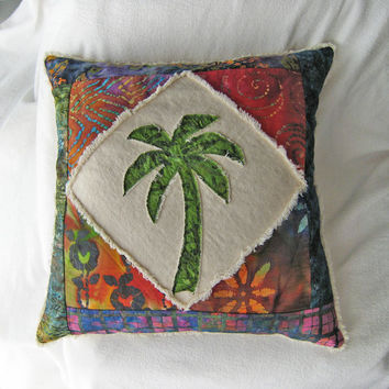 Quilted patchwork palm tree boho pillow cover, with green, red, and purple batiks and natural distressed denim 20""