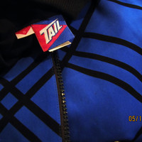 vintage royal blue and black windbreaker. made by Tail.