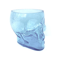 It's a cool skull shape and color, you can use as flowers vase or planter.