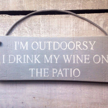 funny sign. funny gift. i'm outdoorsy i drink my wine on the patio.