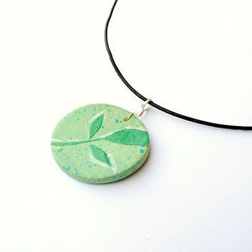 Light green leaf pendant necklace. Nature pendant on a black leather cord. Green pendant. Green necklace. Leaves jewelry. Woodland pendant.