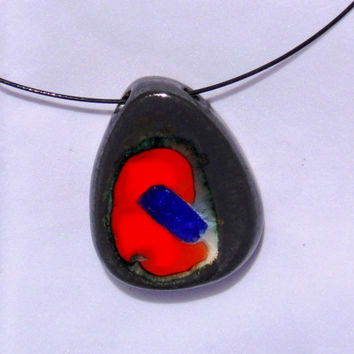 Black stone pottery jewelry pendant makes its mark with deep red glasses