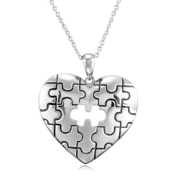 A Piece of My Heart Puzzle Necklace in Sterling Silver