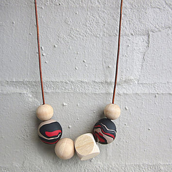 NL-094 Beige Red and Black Patchy Swirl Pattern Polymer Clay and Wooden Bead Necklace in Adjustable Leather Cord