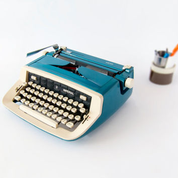Retro 1970's Blue Manual Safari Imperial Typewriter. Made in Portugal. In Good Condition.