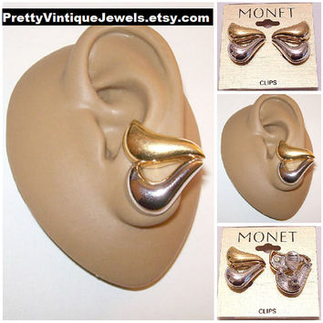 Monet Wave Swirl Puff Clip On Earrings Gold Silver Tone Vintage Open Slotted Polished Curved Graduated Band Large Buttons
