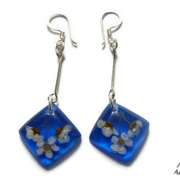 Earrings with small real flowers. Blue dangle earrings. Resin jewelry with pressed flowers. Long dangle earrings.