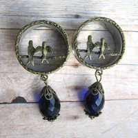 "Pair of Antique Brass Bird Plugs with Blue Glass Beads - 1"" Gauges"