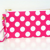 Ring Around the Rosy: This meduim size wristlet will fit all size phones and much more. I phone 6 plus and galaxy note 4