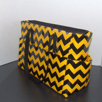 "Tote/Diaper bag in large chevron black and gold print,  with vinyl laminated fabric exterior. ""Go Shocers & Steelers!""!"