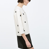 Embroidered polka dot top