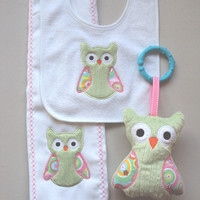 Baby set of a green and pink owls, includes bib, sofite toy and burp. Can be personalized for an extra charge.