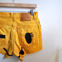 yellow winky face cutoffs