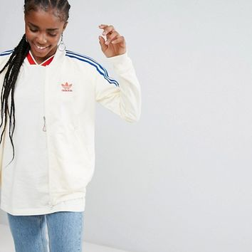 adidas Originals Embellished Arts Bomber Jacket With Butterfly Embroidery at asos.com