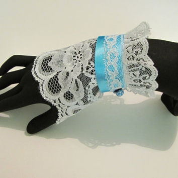 Lace bracelet cuff with blue ribbon and bead closure
