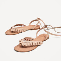 FLAT LEATHER SANDALS WITH FRILLS DETAILS