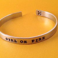 Girl On Fire- Hand Stamped Aluminum Bracelet- Hunger Games Inspired Katniss Quote