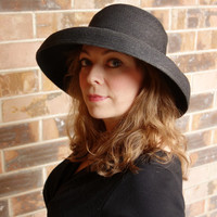 Black rafia hat, cloche hat with wide rounded brim, bell shaped winter hat