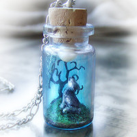 Wolf howling into the moon, polymer clay scene bottle necklace