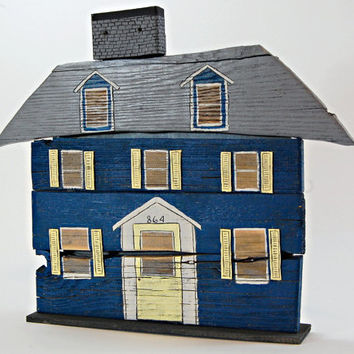 Blue Wooden House Crafted from Reclaimed Wood