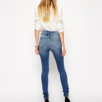 ASOS Ridley High Waist Ultra Skinny Jeans in Busted Mid Wash Blue with Busted Knees