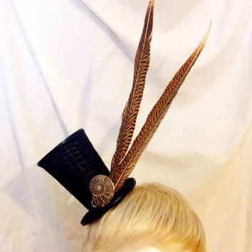 Black and brown long pheasant tail feather and ammonite fossil mini top hat fascinator