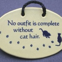 No outfit is complete without cat hair. Mountain Meadows Pottery ceramic plaques and wall art signs with sayings and quotes about cats and pets. Made by Mountain Meadows Pottery in the USA.