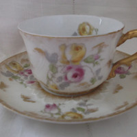 Limoges bone china tea cup and saucer by Charles Field Haviland.  Antique cup and saucer