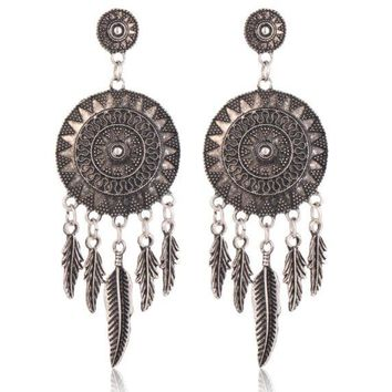 ONETOW Temperament wild earrings to catch the dream of the same national customs retro carved feathers tassel earrings