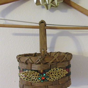 Oval Woven Basket With Red and Green Woven into the Basket - Gold Glitter Leaves With Green and Red Bling Flower